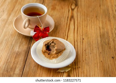 Holiday mood with tea, dessert over wooden background