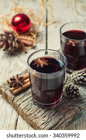 holiday mulled red wine on wooden background. toned image