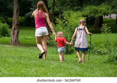 holiday in nature. mother and daughters having fun on the lawn