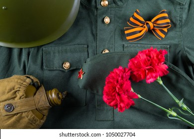 a holiday on May 9 with a St. George ribbon and two carnations, on the background of military clothes