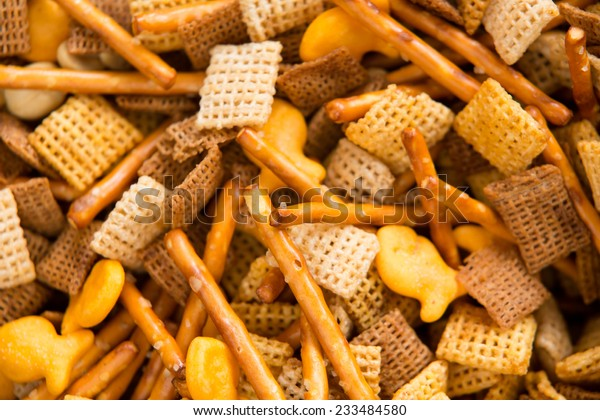 Holiday Party Food Mix - This is a close up shot of a Chex party mix containing cereal, crackers and pretzels.