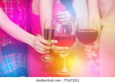 Holiday party : Three women drink a glass of wine to celebrate a happy party.