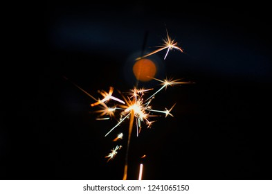 holiday pyrotechnics , pyro ,fireworks in hand, firework at night , lights