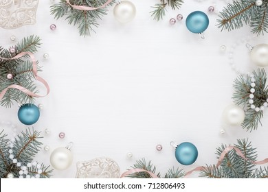 Holiday round Frame with New Year decoration and fir,  blue and pearly balls. Christmas greeting card