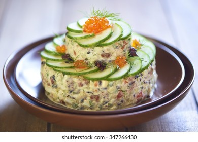 Holiday seafood salad with red caviar and black rice
