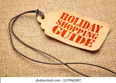 Holiday shopping guide sign - a paper price tag with a twine iagainst burlap canvas