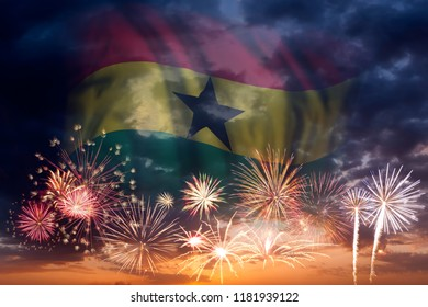 Holiday sky with fireworks and flag of Ghana, independence day