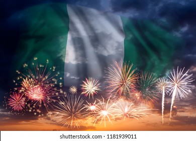 Holiday sky with fireworks and flag of Nigeria, independence day