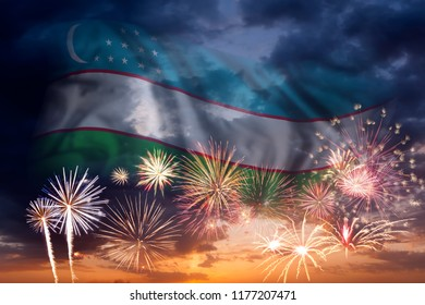 Holiday sky with fireworks and flag of Uzbekistan, independence day