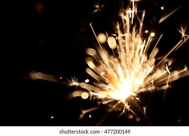 Holiday sparklers on black background