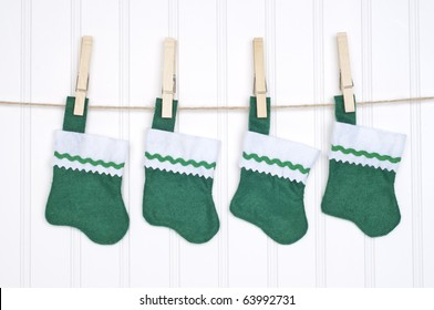 Holiday Stockings Hanging on a Clothesline on a White Background.