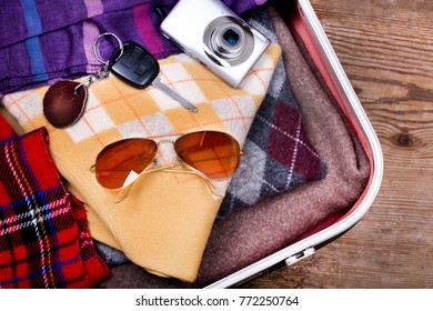 Holiday suitcase and accessories. Travel concept