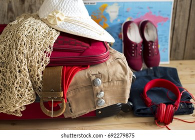 Holiday suitcase and summer accessories. Travel concept