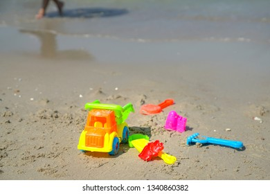 Holiday and summer concept, kids toys at the sandy beach