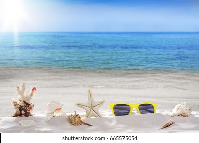 Holiday summer, sunglasses, Starfish, seashells,  on seashore - landscape beach background