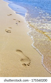 Holiday symbol of quiet rest in attractive areas on the beach, with visible footprints in the sand.