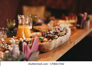 holiday table with food, snacks, drinks, dishes