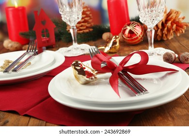 Holiday table setting with Christmas decoration background