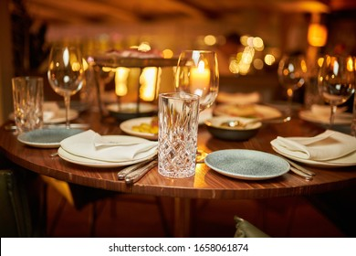 holiday table setting. glasses, plates, knives and forks on the table. tableware
