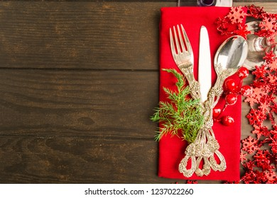 Holiday table setting with red color on wooden table with copy space, flat lay