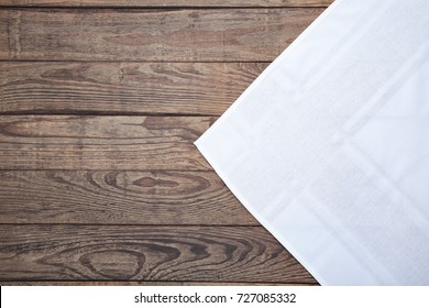 Holiday tablecloth on the wooden boards. Vintage wooden table top view mock up.