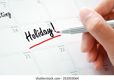 Holiday text on the calendar (or desk planner) underlined with red marker
