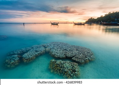 Holiday in Thailand - Beautiful Island of Koh Lipe Sunset with coral