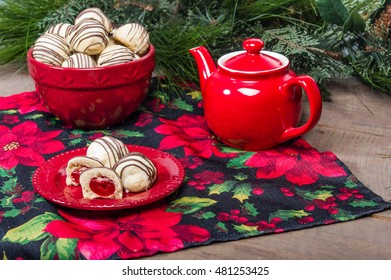 Holiday themed tea pot and filled Christmas cookies
