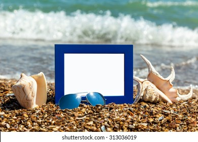 Holiday time, There's a photo frame with sunglasses and shells against the sea shore with swirling waves, photo frame on the beach, photography on the beach, sea shells, beach vacation, beach pebbles,