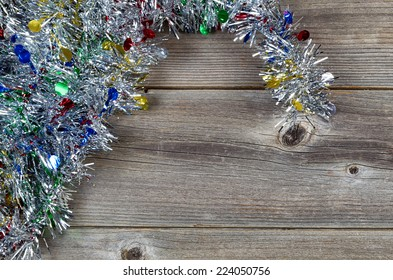 Holiday Tinsel on Rustic Wood