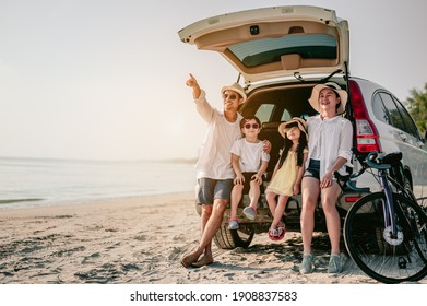 Holiday and travel family concept, Summer vacations.Happy family enjoying beach trip with their favorite car. Parents and children are traveling the way to the sea.