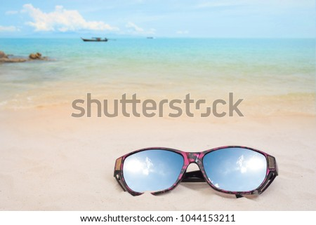 7262b60c27e0 Holiday travel sunglasses on sand beach and sun reflect. Empty space you  can place your