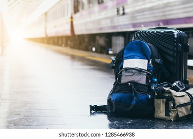 Holiday vacation smart travel plan trip with map. Young hipster solo tourist at train platform ready to explore new destination active adventure experience in traditional culture witn local transport