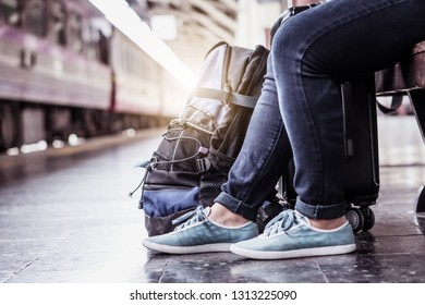 Holiday vacation smart travel plan with  young hipster solo tourist explore new active adventure experience with sustainable local culture on traditional train. Waiting on platform in summer