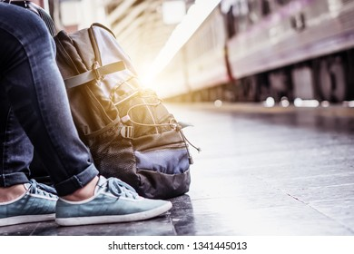 Holiday vacation travel of young solo hipster backpacker tourist. Smart plan to explore new active adventure with experience local culture in summer. Use traditional train for transportation