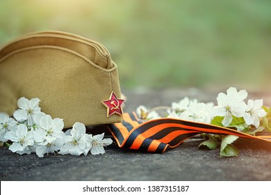 holiday Victory Day background. George ribbon, flowers and military cap. Victory Day, may 9, 1945.  template background celebration of may 9, Victory Day. copy space