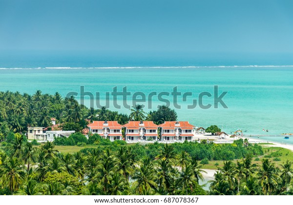 Holiday village on Minicoy tropical island, Lakshadweep with turquoise sea and blue sky