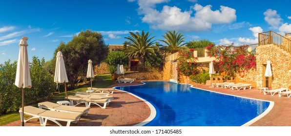 Holiday villas and pool on a hot summers day.
