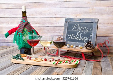 Holiday wine flight with chalkboard sign and decorations