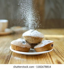 Holiday winter background with muffins decoration with powdered sugar