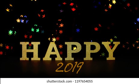A holiday word HAPPY over festive blurred background, anniversary and holidays concept, congratulations with anew years and birthday, place for text, banner format