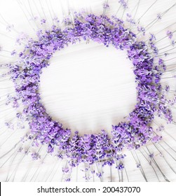 A holiday wreath with greens and lavender flowers