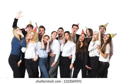 Holiday. Young beautiful people having fun on a white background. Concept celebrating New Year or Christmas.