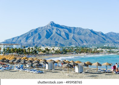 Holidaymakers relaxing on the beach, Puerto Banus, Marbella, Costa del Sol, Malaga Province, Andalusia, Spain, Western Europe, August 2016
