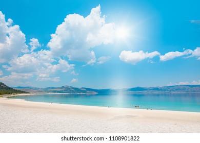 Holidaymakers sunbathing at Salda white beach - Salda Lake, Burdur - Turkey