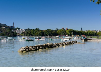 holidays in annecy lake with pedal boat and boat in summer