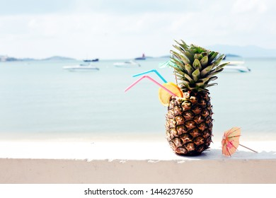 holidays beach background with pineapple coctail