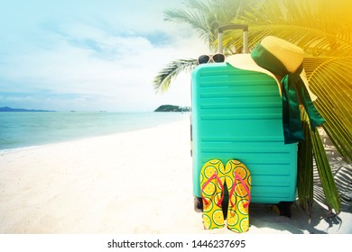 HOLIDAYS BEACH BACKGROUND WITH SUITCASE