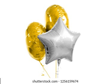 holidays and birthday party decoration concept - three metallic gold and silver helium balloons of different shapes over white background
