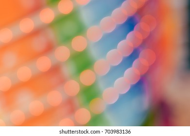 Holidays bokeh joyful illuminated bright glowing decorative background concept. Blurred festive decoration or garland lights